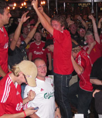 Liverpool Fans celebrate in The Irish House